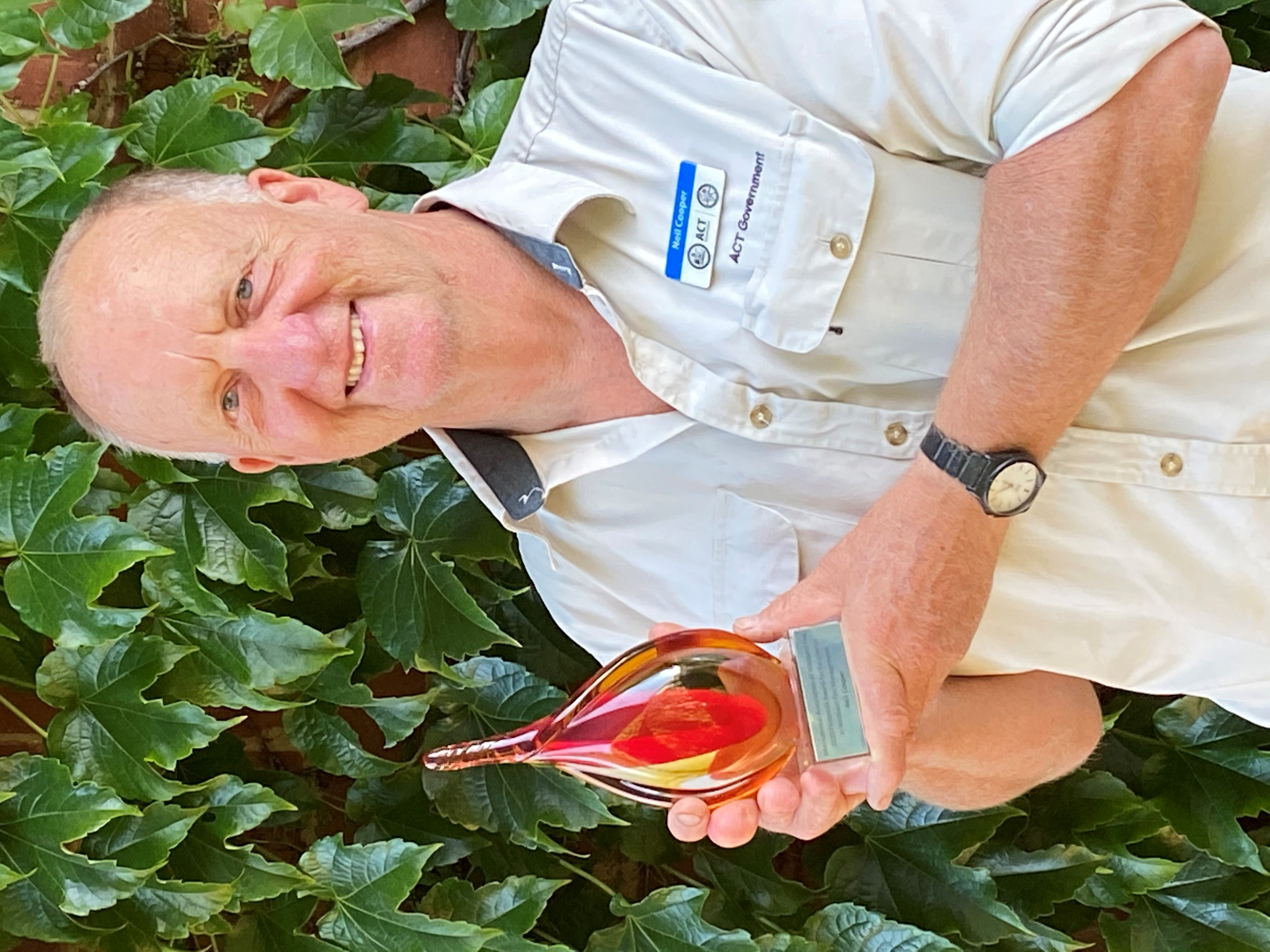Neil Cooper (ACT Parks and Conservation Service) with his Firebreak Award for Excellence in Wildland Fire Management