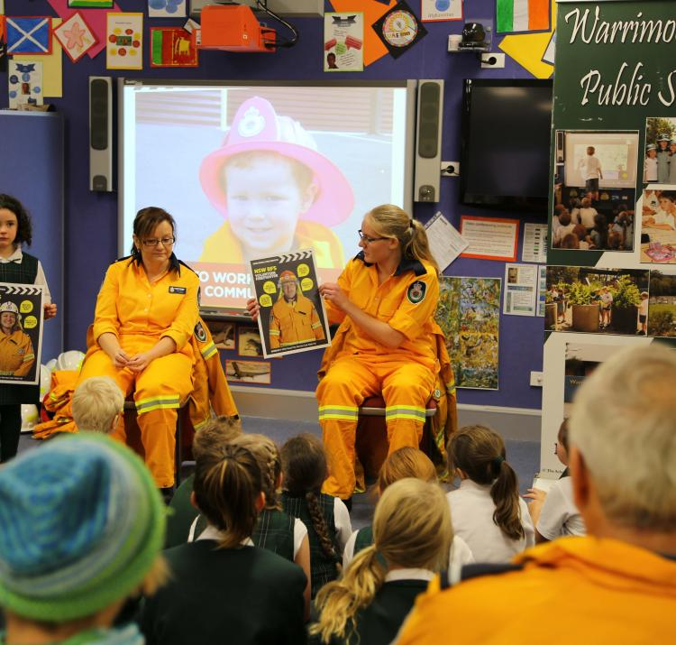 RFS personnel using the new guide at Warrimoo Public School. Photo Ben Shepherd, NSW RFS
