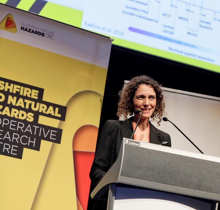 Dr Marta Yebra presenting her fire science in Perth.