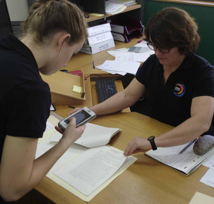 Researchers Becc D'Arcy and Lucinda Coates recording data from coronial inquest files.