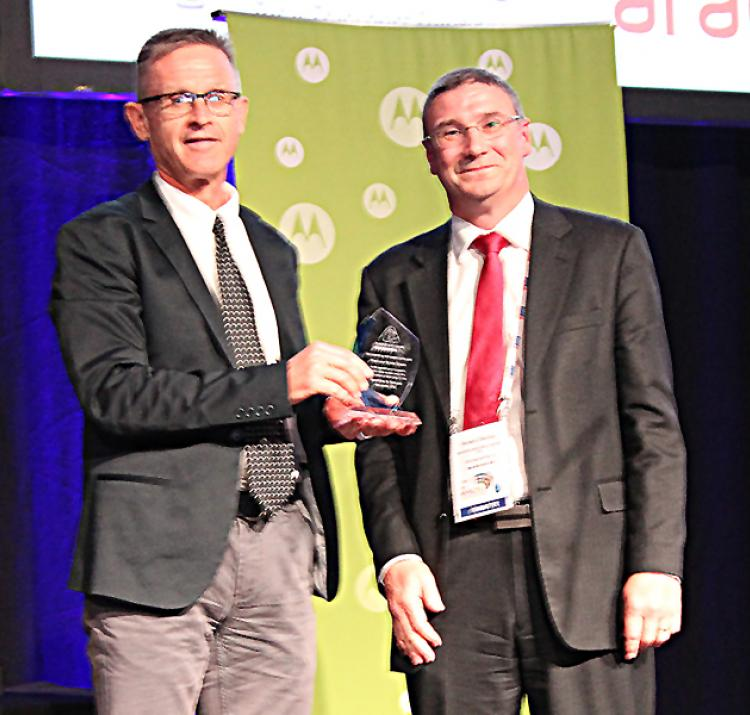 Kevin Ronan receives award from Richard Thornton
