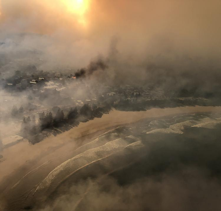 Tathra during the bushfire. Photo: Caleb Keeney, Timberline Helicopters.