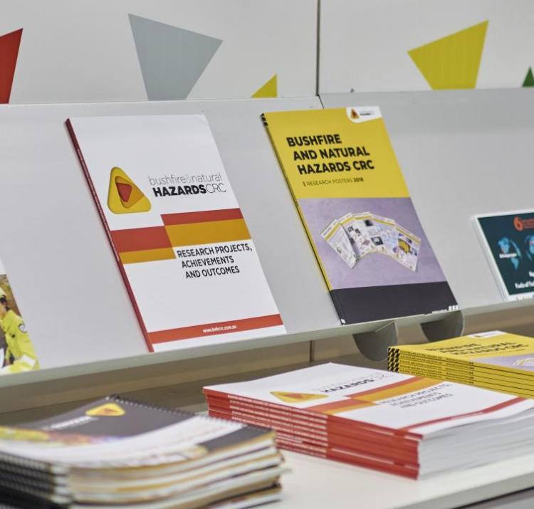 A display of CRC publications at a conference booth is pictured.
