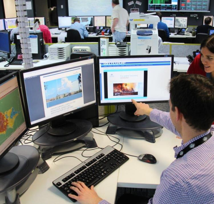 Fire weather forecaster Steven McGibbony uses the Spot Fire Forecasting course online from the Victorian Regional Forecasting Centre with Fire Weather Training Program Manager, Monica Long.