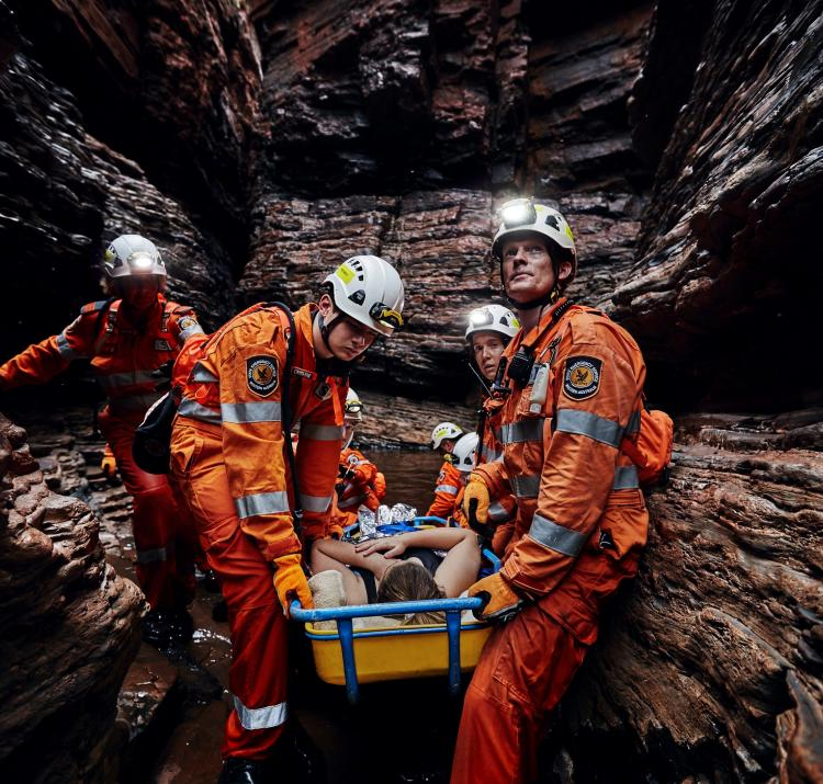 A crew of State Emergency Service volunteers perform a cave rescue.