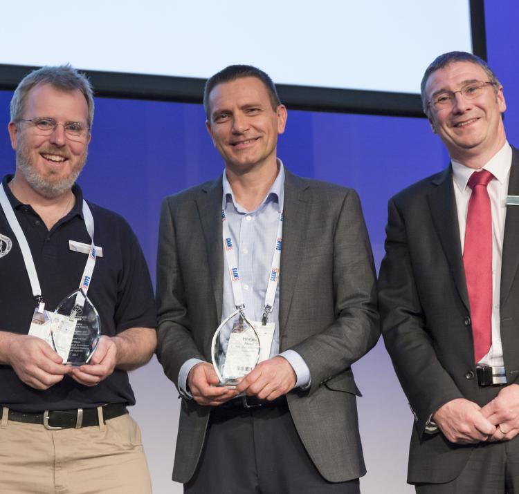 Ed Pikusa and Holger Maier receive their outstanding achievement award from Dr Richard Thornton.