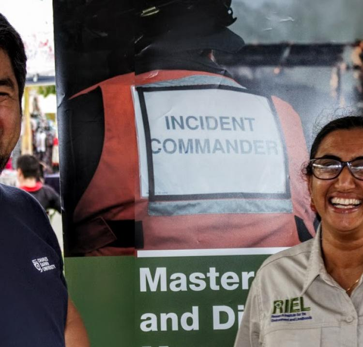 Dr Kamaljit Sangha (right) talks natural hazards research at the Palmerston Markets.