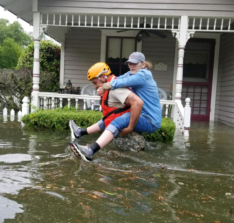 Texas National Guard rescuing a Houston resident during Hurricane Harvey. Photo Texas National Guard CC BY 2.0