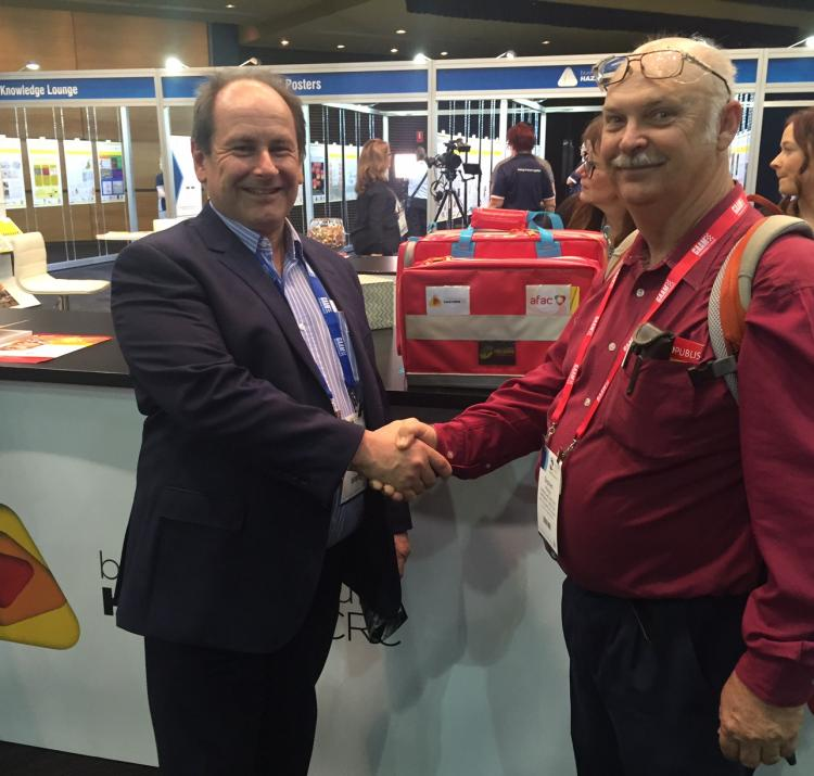 RAPP Australia's Roger Buckle presents Stephen Phillips with the first aid kit.