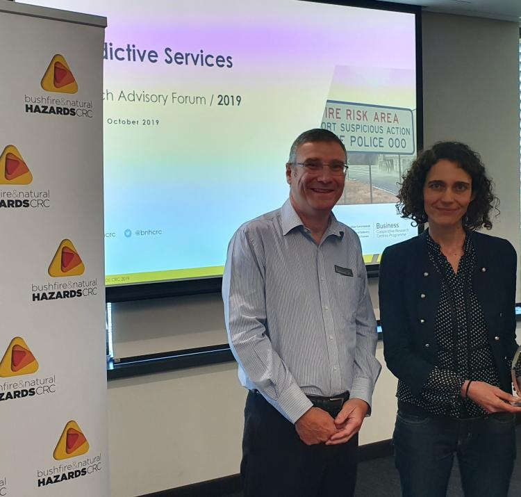 Dr Richard Thornton (left) presenting Dr Marta Yebra (middle) with the 2019 Outstanding Achievement in Research Utilisation award for her research that she has done alongside lead end-user Dr Adam Leavesley (right).