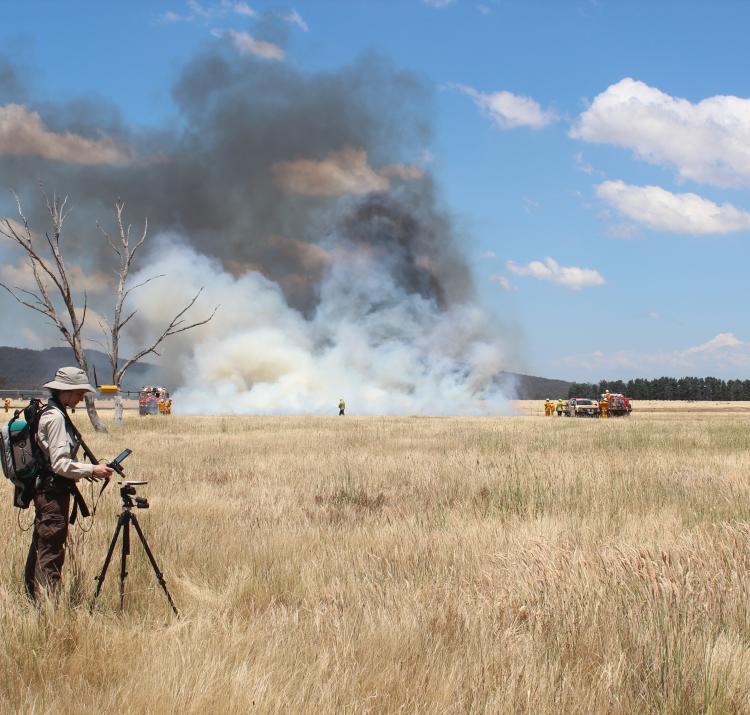 Dr Marta Yebra in the field conducting a grass fire experiment. Photo: Carolina Luiz.