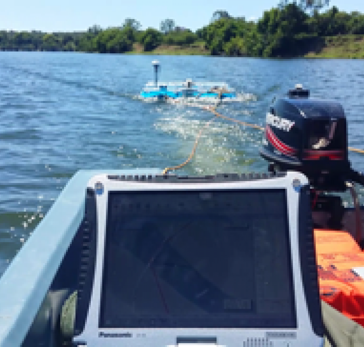 The research team uses a river surveyor acoustic doppler profiler to measure the topography of the Clarence River upstream of Grafton in NSW. Photo: Stefania Grimaldi