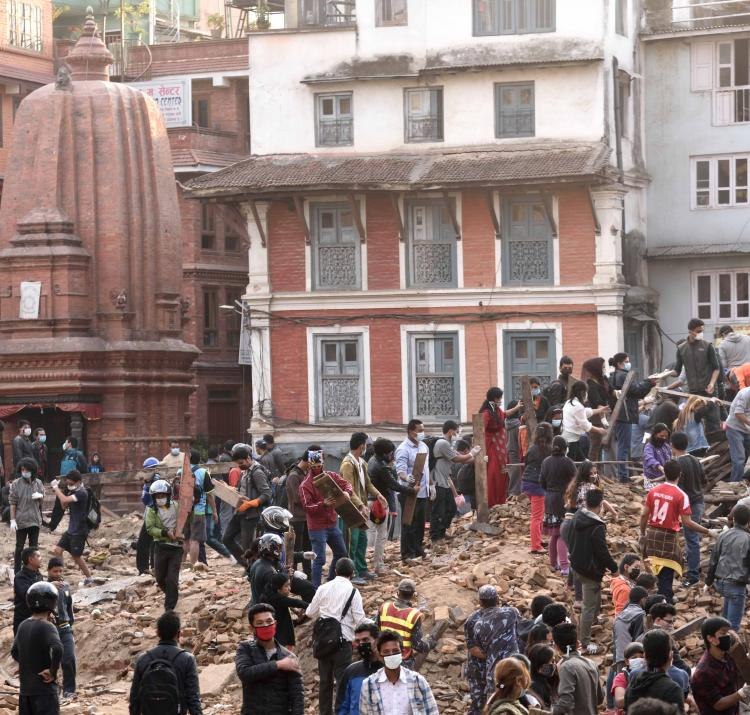 Rescuers clear rubble in the search for survivors in Durbar Square Kathmandu, Nepal, after the first earthquake on 25 April 2015. Photo by Think4Photop, Shutterstock.