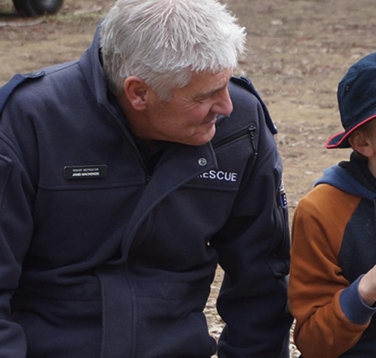 A child learns how measure wind speed so that he can calculate the local fire danger rating. © Strathewen Arthurs Creek Bushfire Education Partnership, Victoria, Australia, 2017.
