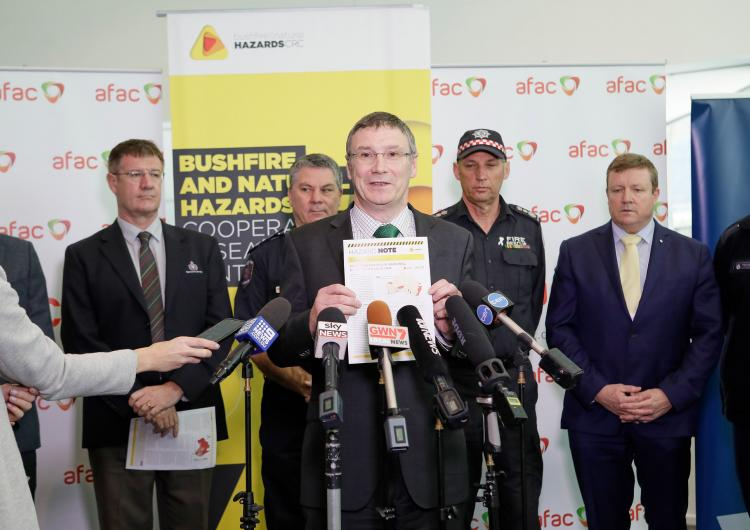Dr Richard Thornton speaks at a media conference.