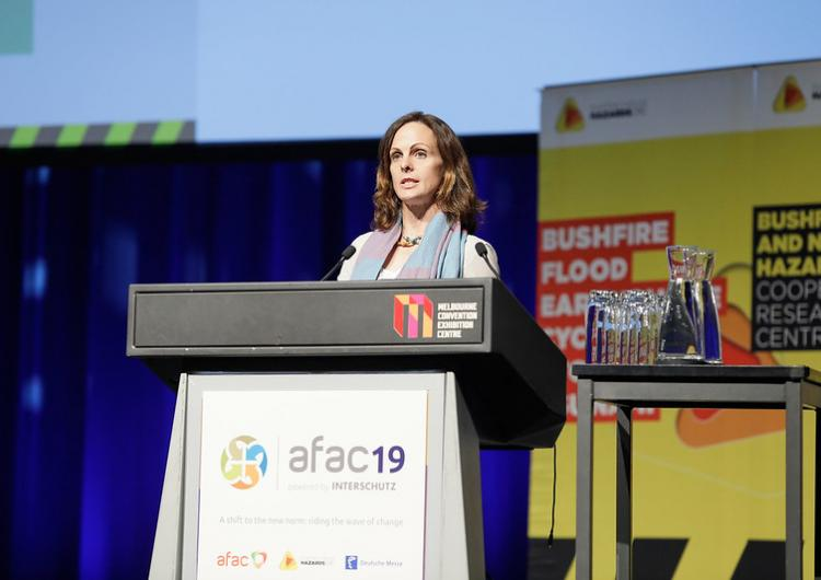 Dr Mika Peace presenting at the AFAC19 conference.