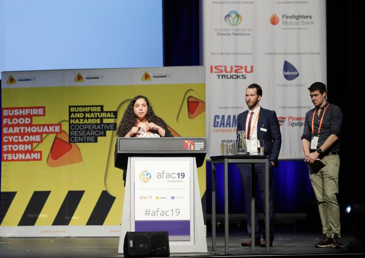 Dr Chermelle Engell presenting with Andy Ackland and Dr Alex Holmes at the CRC's Research Forum at AFAC19.