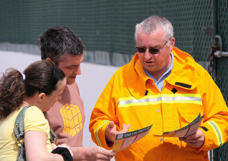 A fireman explaining a fire plan to the public. Photo: Country Fire Authority