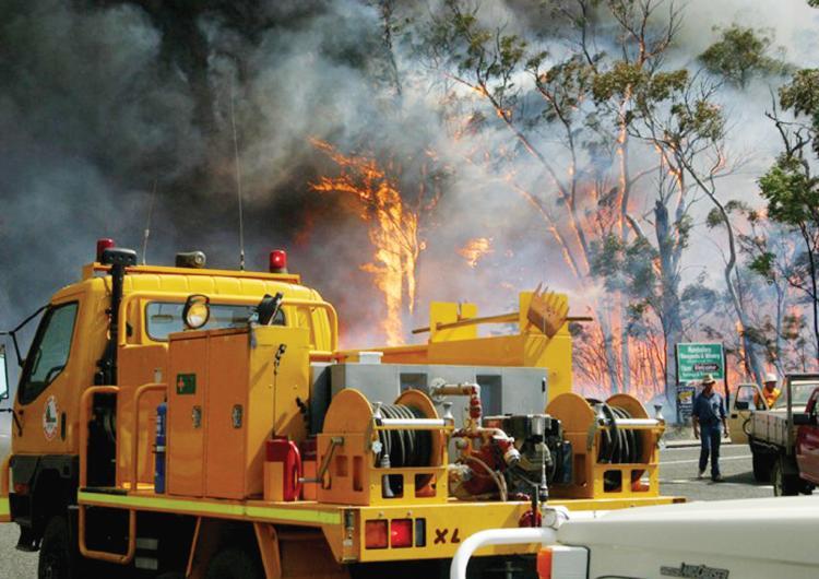 Emergency service personnel attending bushfire. Photo:QFES.