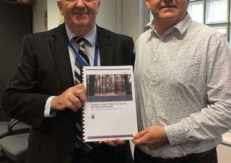 Doug Hart (left) was acknowledge for his Black Saturday report by the chair of the AFAC Community Safety Group Andrew Stark.
