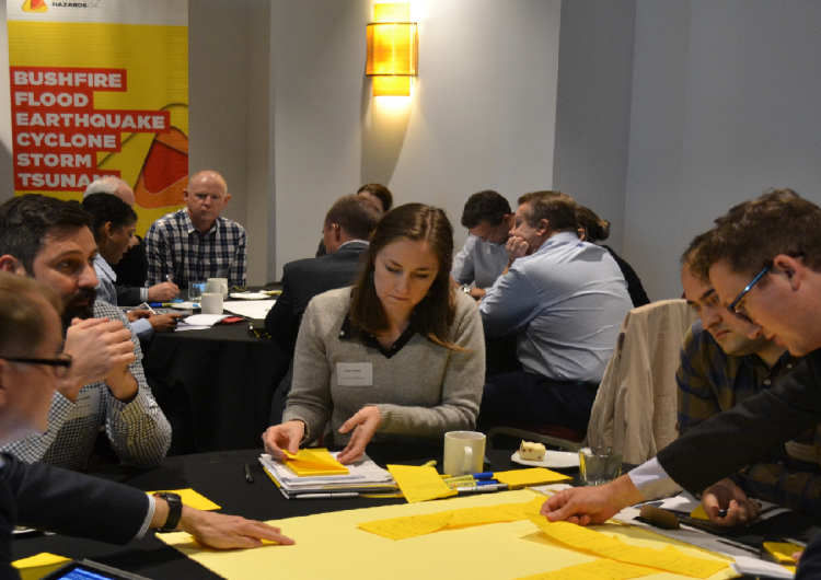 Attendees discussing the the role of electricity networks in bushfire mitigation.