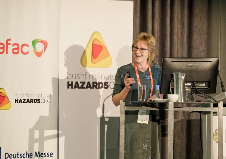 PhD student Heather Bancroft presenting her research on the mental health of Australian firefighters at AFAC18 powered by INTERSCHUTZ.