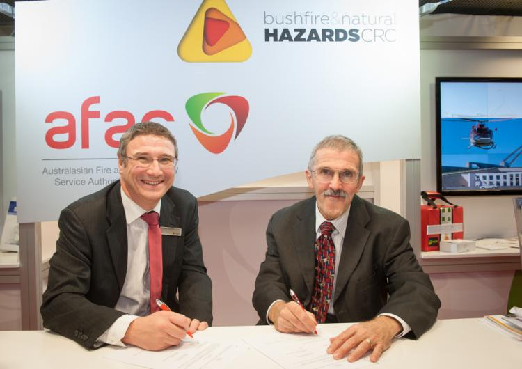 Richard Thornton and Tom Harbour sign the MOU