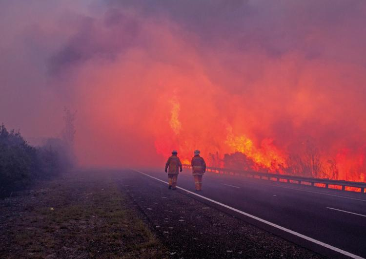 The NSW Rural Fire Service and Tasmania Fire Service fighting the Tasmanian fires in early 2016. Photo: Mick Reynolds, NSW RFS