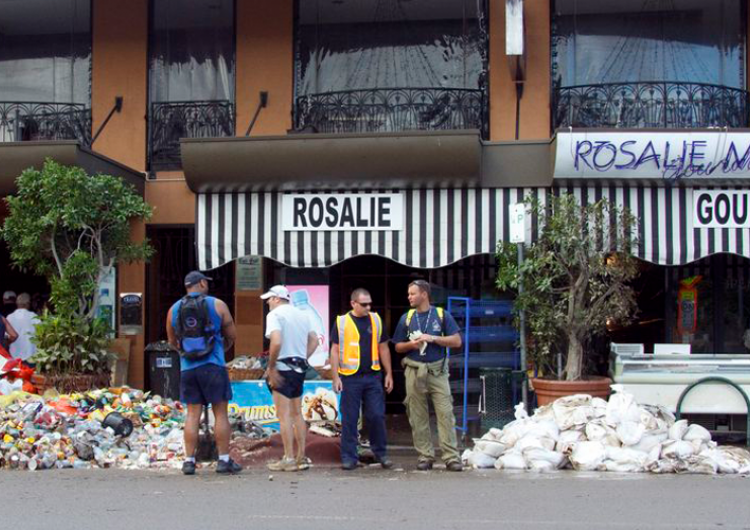 Local businesses assessing the impacts of the Brisbane floods in 2010–11 on their stock. Photo: Angus Veitch (CC BY-NC 2.0)