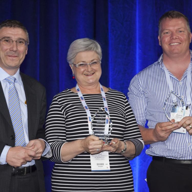 Richard Thornton presenting the Outstanding Achievement award to Prof Vivienne Tippett and Andrew Richards.