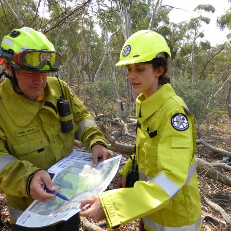 Adam Leavesley and Marta Yebra planning field work. Photo by Geoff Cary