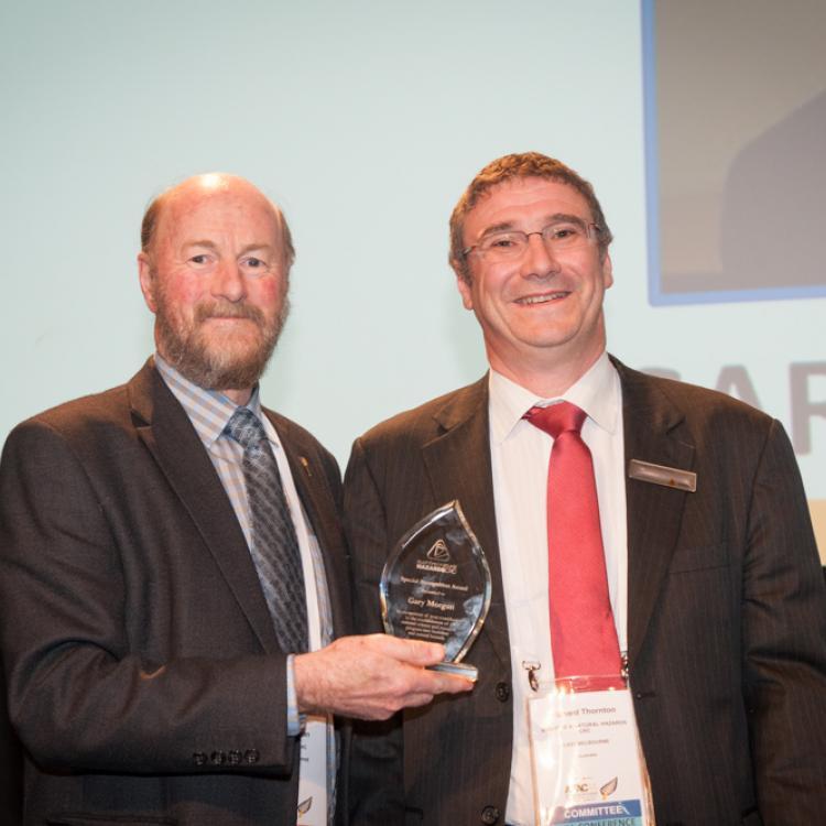 Gary Morgan receives his award from Richard Thornton