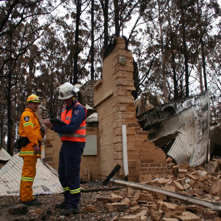 Assessing a burnt house after Black Saturday.