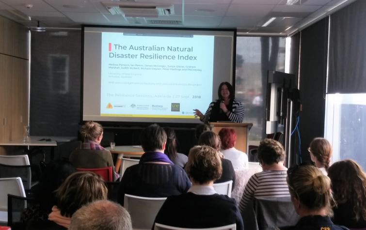 Dr Melissa Parsons presenting her research to practitioners and attendees during the event.