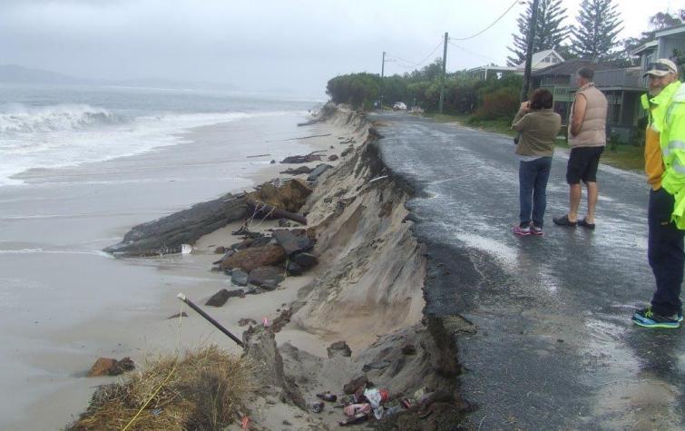 Coastal erosion from a storm surge.
