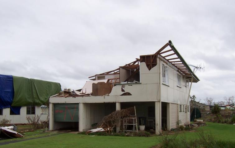Wind induced damage to a legacy house, TC Yasi.