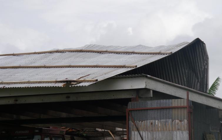 Wind damage to roof from cyclone Ului in Queensland, 2010.
