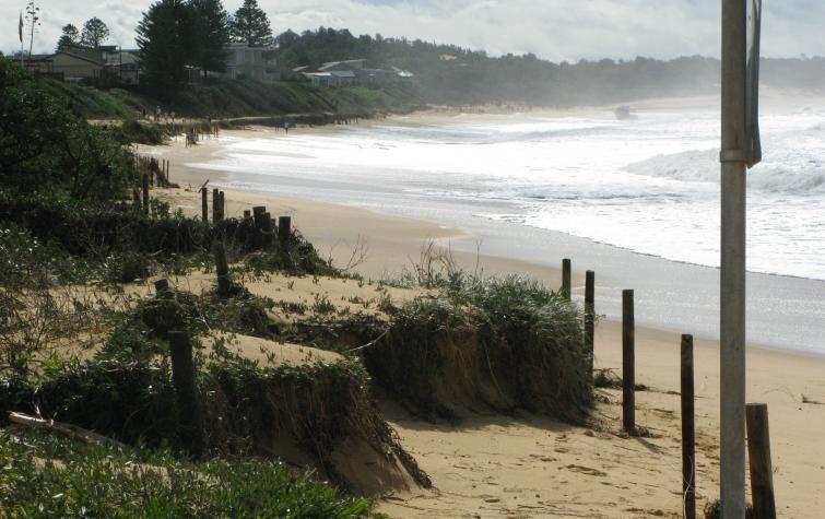 Evidence of coastal erosion occurring along the strip of beach.