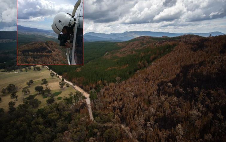 CRC researcher Marta Yebra in a helicopter flying over the Pierces Creek fire. Photo: Marta Yebra.