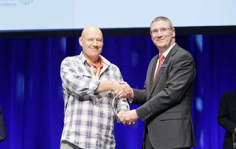 Dr Adam Leavesley accepting the award for Outstanding Achievement in Research Utilisation at AFAC19