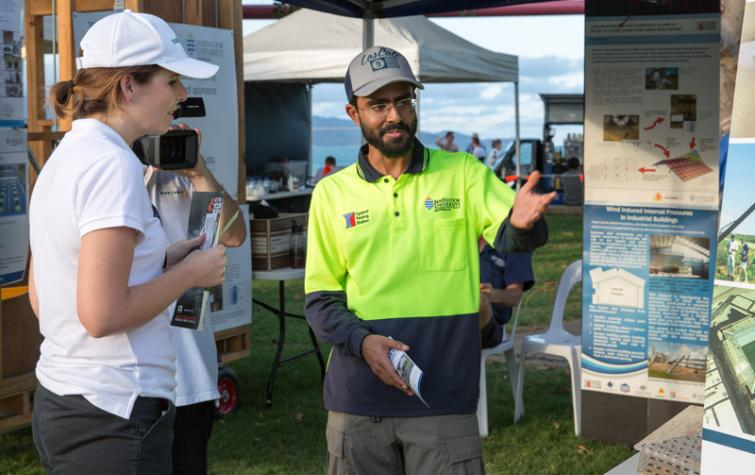 PhD researcher Korah Parackal talks about his research at a cyclone awareness day in Townsville.