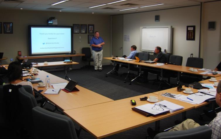 Darryl Dixon presenting his research in 2013.