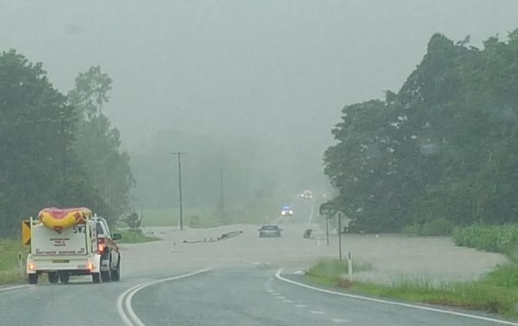 The SES getting ready to rescue a driver stuck on a flooded bridge. Photo: Davina Pearson