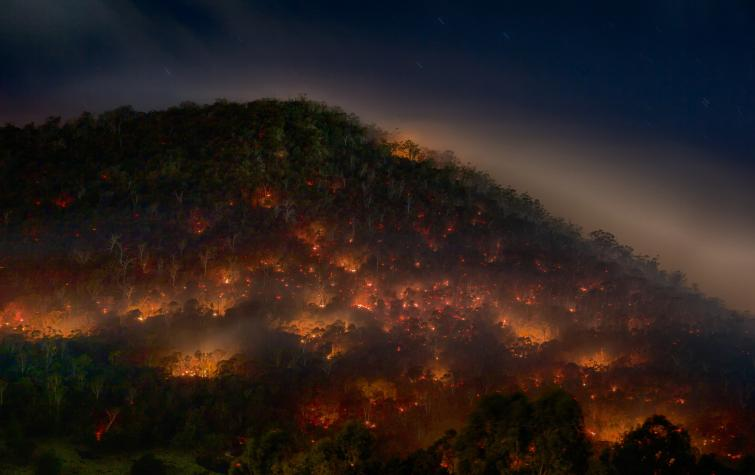 A prescribed burn at night. Photo: Mike Rowe (CC BY-NC 2.0)