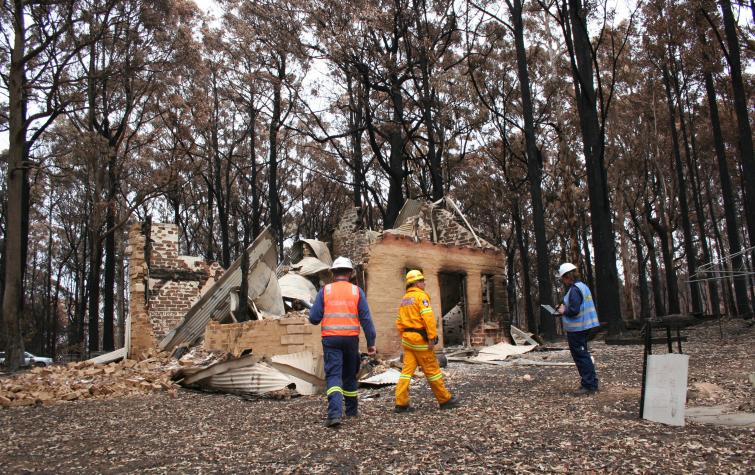 CRC researchers studying a house that burnt down on Black Saturday.