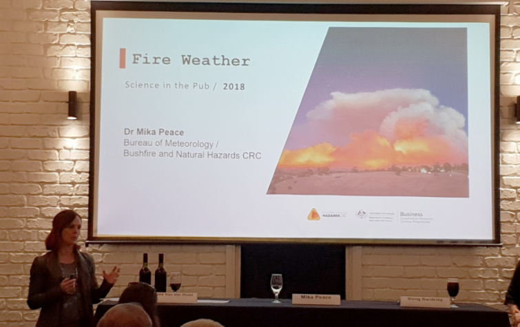 Dr Mika Peace presents her fire research at a pub in Adelaide.