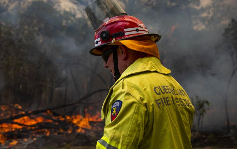Image of a firefighter during the 2018 Queensland bushfires. Photo: Queensland Fire and Emergency Service.