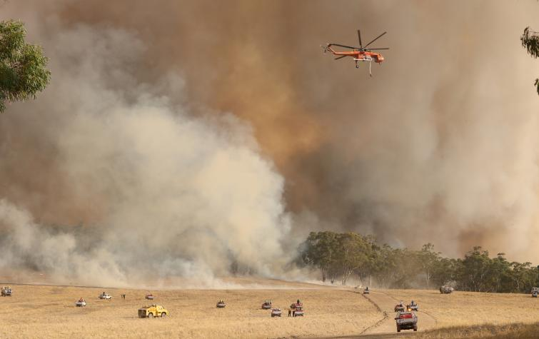 An Erickson Aircrane and fire units battle the Bangor fire in January 2014. Photo by Tait Schmall/Newscorp