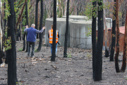 An interviewee shows a researcher the impact the bushfire had on his property. Photo: NSW Rural Fire Service.