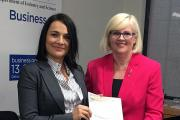 Dr Kat Haynes accepts her award from Karen Andrews MP.
